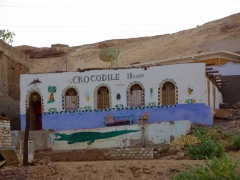 "The colorful exterior of the ""crocodile house"", in a Nubian Village where the majority of homes are protected by a stuffed crocodile; First Cataract on the Nile River"