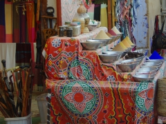 Colorful display of spices and various other souvenirs for sale; Nubian Village