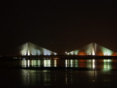 A bridge in Aswan lit up at night; as seen from our felucca