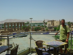 Robby poses on the balcony of Snack Time, overlooking the Luxor Temple complex