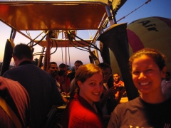 Ally and Becky smile as they prepare to take off in their hot air balloon; Valley of the Kings