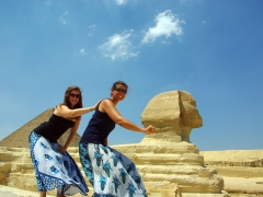 Ally and Becky ride the Sphinx in Cairo