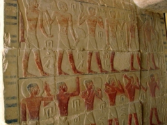 Slaves carrying offerings inside a tomb in Saqqara