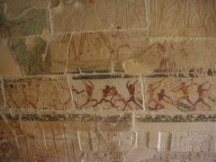 A vivid and colorful battle scene depicted inside a tomb at Saqqara