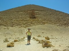Becky standing at the base of Dahshur's Red Pyramid, which is well worth the E₤ 30 entry fee to explore the interior of the oldest pyramid in Egypt