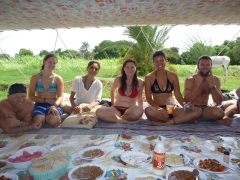 Lucky, Kendra, Lisa, Marie, Becky and Robby smile as lunch is served on our felucca; Nile River
