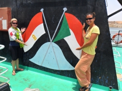 Ally and Becky in front of the Sudan and Egypt flags on board our Wadi Halfa-Aswan Ferry