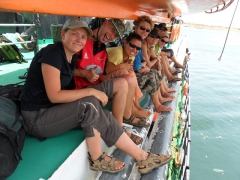 Anna, Damien, Becky, Lars, Marie, Ally and Lucky swelter beneath the life boat on board the Wadi Halfa-Aswan ferry as it pulls into port at Aswan