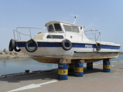 A funny sight as a police boat appears stranded by the Aswan harbor
