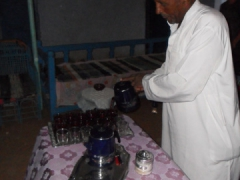 Our Nubian Village host pours us a welcome chrysanthemum tea drink