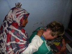 Lars gets a henna tattoo on his neck; Nubian Village