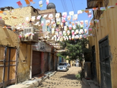 Colorful Ramadan flags decorate a street in Aswan