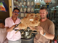Robby holds up fresh bread; Aswan Souq
