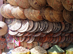 Traditional table mats and baskets for sale; Aswan Souq