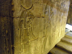 "Carved figurines ""walking"" up the staircase; Edfu"
