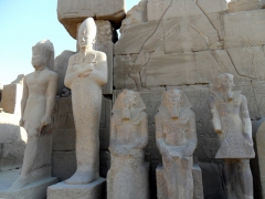 Standing and seated pharaoh statues; Karnak