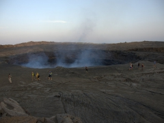 Our travel companions look tiny as they walk around Erta Ale lava lake