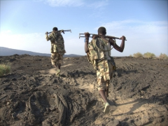 Our Ethiopian military security force on the hike down from Erta Ale volcano (notice their plastic flip flops with rifles slung across their backs...no quick reaction force if Eritrean rebels decided to attack)