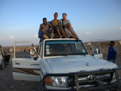 Our guide, Fiona and Becky on the roof of our 4x4 on a drive out to salt lake; Danakil Depression