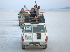 Mickey, Cat and Ngassi wave from their rooftop on our drive to the salt lake; Danakil Depression