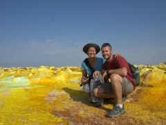 Posing before the fantastical hues of Dallol