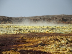 Dallol is famous for its hot brine and multicolored white, red, yellow, green, gray and black salt deposits, hot springs and miniature geysers