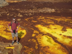 Robby stands on the salt crusted ridges of Dallol