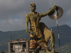 Statue of a warrior and lion at a roundabout in Arba Minch