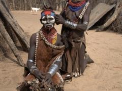 A Karo woman styles her friend's hair; Kolcho Village