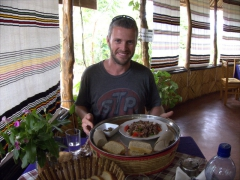 Robby shows off his lamb tibs at the Buska Lodge; Turmi