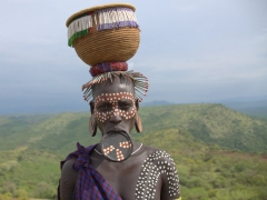 Our first glimpse of the most fascinating tribe in the Omo Valley, the Mursi Tribe. Numbering at 5,000 individuals, the mursi women are the most identifiable with their pierced lips stretched to hold a clay lip plate