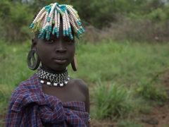 A Mursi girl with massive ear plugs