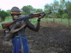 Mursi man showing off his AK-47
