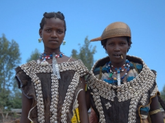 Banna women at the Key Afar market. The Banna women commonly wear a half calabash (used for drinking) as a helmet whenever its is not in use