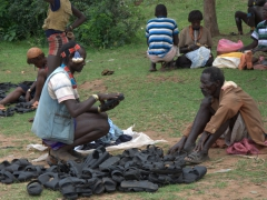 Banna men negotiating the price of tire sandals