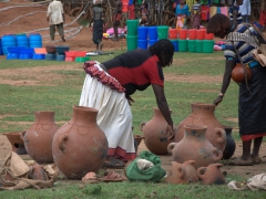 A Konso pot seller shows off her wares at the Key Afar market. (Konso women wear a traditional hand loomed skirt with a flounce around the waist)