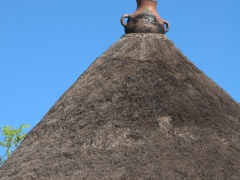 A cross decoration at the top of this Konso hut signifies that its inhabitants are Christian