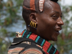 Profile of a Banna man with clay bun