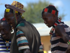 Banna men laugh in amusement at the Dimeka Market