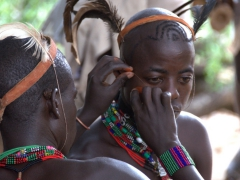 While the girls are getting whipped, the Hamer men painstakenly apply face paint for their role in the bull jumping ceremony