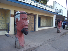 Massive wooden carvings outside of Fawlty Towers, a popular backpacker's joint in Livingstone