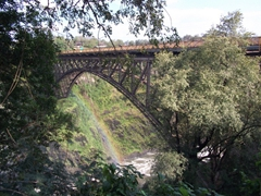 The bridge over the Zambezi River (no man's land where bungee jumpers hurl themselves off); Victoria Falls
