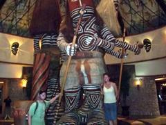 "Standing next to massive statues at ""The Kingdom""; Victoria Falls"