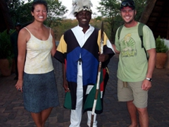 Posing with a Boma restaurant greeter; Victoria Falls