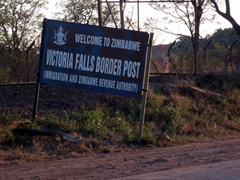 """""""Welcome to Zimbabwe"""" sign at the Victoria Falls border post"""