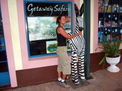 Becky posing beside a zebra statue; Victoria Falls