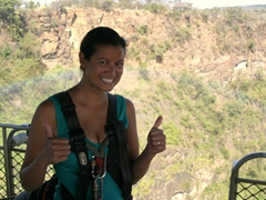 Despite being petrified, Becky flashes a nervous smile and gives the thumbs up sign mere seconds before leaping 111 meters over the Zambezi River