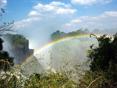 A rainbow appears over the Devil's Cataract; Victoria Falls