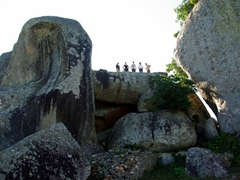We look like tiny ant figures atop the King's stone throne; Great Zimbabwean Ruins