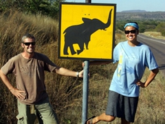 """Posing next to a """"caution, yield to elephant"""" sign"""